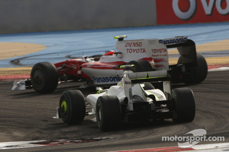 Timo Glock, Toyota F1 Team and Rubens Barrichello, Brawn GP