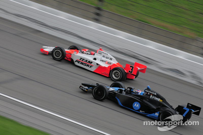 Danica Patrick, Andretti Green Racing passing Helio Castroneves, Penske Racing