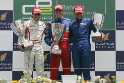 Luiz Razia celebrates winning his first GP2 Asia race on the podium with Jerome D'Ambrosio and Davide Rigon