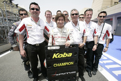 Kamui Kobayashi celebrates his GP2 Asia championship with his team who also collected the team championship