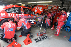 Tony Stewart, Stewart-Haas Racing Chevrolet, watches as his team repairs his #14 Old Spice Chevy