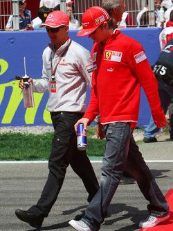Heikki Kovalainen, McLaren Mercedes and Kimi Raikkonen, Scuderia Ferrari