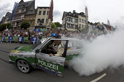 A polizei car in a burnout and drift session