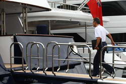 Dr. Mario Theissen, BMW Sauber F1 Team, BMW Motorsport Director going to the FOTA meeting on the boat of Flavio Briatore, Renault F1 Team, Team Chief, Managing Director