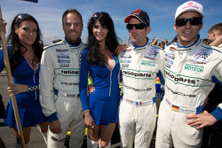 Marcel Tiemann, Romain Dumas and Timo Bernhard pose with charming grid girls