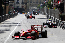 Kimi Raikkonen, Scuderia Ferrari leads Sebastian Vettel, Red Bull Racing