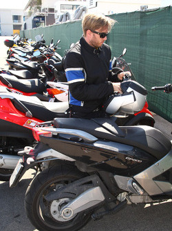 Nick Heidfeld, BMW Sauber F1 Team arrives at the circuit on a motorbike
