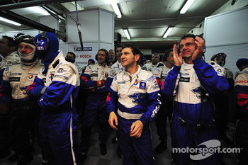 Peugeot team members celebrate Stéphane Sarrazin's pole position