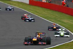 Sebastian Vettel, Red Bull Racing leads Rubens Barrichello, Brawn GP