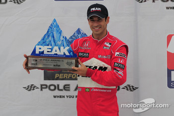 Helio Castroneves with his pole award