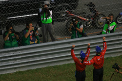 Race winners Ronnie Quintarelli and Hironobu Yasuda celebrate