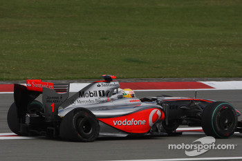 Lewis Hamilton, McLaren Mercedes with his damaged rear tyre