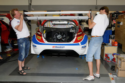 Drivers Andreas Eriksson and Marcus Gronholm help with the preparation of one of their Ford Fiestas prior to practice for the Pikes Peak Hillclimb