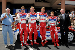 Chairman of the Pikes Peak International Hillclimb Bob Gillis poses with the Ford challengers, co-driver Per Ola Svenssonand, driver Andreas Eriksson, driver Marcus Gronholm,and Brent Hall, new car manager for Phil Long Ford in Colorado Springs