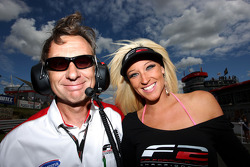 Formula Two engineer with a grid girl