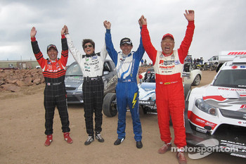 Nobuhiro Tajima celebrates with the team