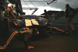 Checking the damage on a Matech GT Racing Ford GT