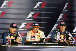 Post-qualifying press conference: pole winner Fernando Alonso, Renault F1 Team, with second place Sebastian Vettel, Red Bull Racing, and third place Mark Webber, Red Bull Racing