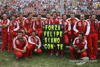 Scuderia Ferrari team members show their support for Felipe Massa