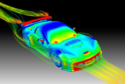 This CFD graphic shows areas of high and low pressure on the GT2 Corvette C6.R body; red on the front fascia, sideview mirrors and wing indicates high pressure; blue on the roof and fenders indicates areas of low pressure