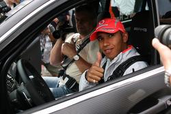 Lewis Hamilton perfoms some laps in a Mercedes C63 AMG