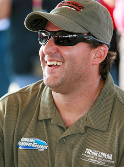 Tony Stewart is all smiles during the drivers meeting