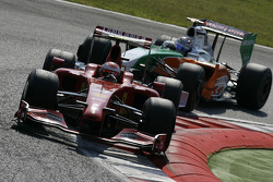Kimi Raikkonen, Scuderia Ferrari and Adrian Sutil, Force India F1 Team