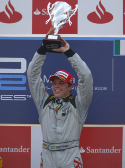 Luiz Razia celebrates his victory on he podium