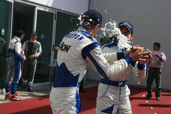 Adriano Buzaid helps Max Chilton out with the Champagne