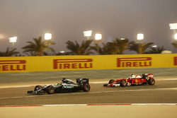 Lewis Hamilton, Mercedes AMG F1 Team W07 and Kimi Raikkonen, Ferrari SF16-H
