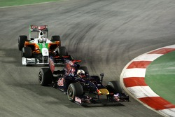 Jaime Alguersuari, Scuderia Toro Rosso leads Adrian Sutil, Force India F1 Team