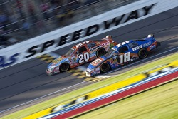 Joey Logano passes Kyle Busch for the win
