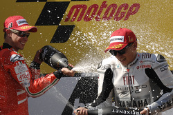 Podium: race winner Jorge Lorenzo, Fiat Yamaha Team celebrates with second place Casey Stoner, Ducati Marlboro Team