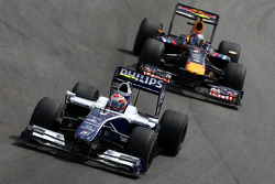 Kazuki Nakajima, Williams F1 Team leads Sebastian Vettel, Red Bull Racing