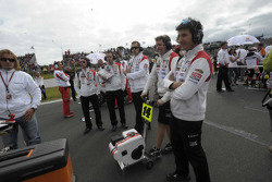 LCR Honda MotoGP team members on the starting grid
