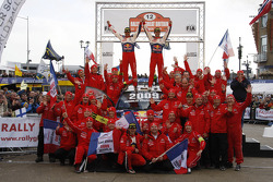 Podium: winners and 2009 WRC champions: Sébastien Loeb and Daniel Elena celebrate with their team