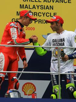 Podium: race winner Casey Stoner, Ducati Marlboro Team with third place and 2009 MotoGP champion Valentino Rossi, Fiat Yamaha Team