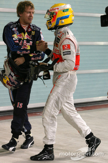 Pole winner Lewis Hamilton, McLaren Mercedes celebrates with second place Sebastian Vettel, Red Bull Racing