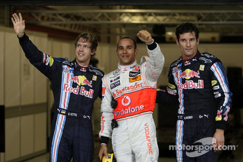 Pole winner Lewis Hamilton, McLaren Mercedes, with second place Sebastian Vettel, Red Bull Racing and third place Mark Webber, Red Bull Racing