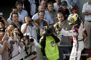 Race winner Andy Soucek celebrates in parc ferme