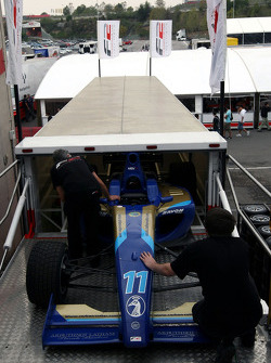 F2 Mechanics load the car of Jack Clarke into the trucks
