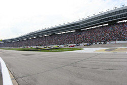 The field takes the green flag before the huge grandstands at Texas Motor Speedway