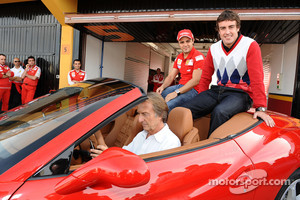 Luca di Montezemolo drives Felipe Massa and Fernando Alonso around the track in a Ferrari California