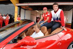 Luca di Montezemolo drives Felipe Massa and Fernando Alonso around the track in a Ferrari California