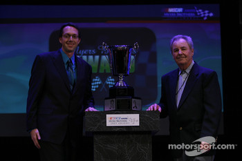 Myers Brothers Awards: National Motorsports Press Association president Dustin Long presents the NMPA Myers Brothers Award to MRN Radio's Barney Hall