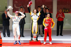 Podium: race winner Romain Grosjean, Barwa Campos Team, second place Vitaly Petrov, Barwa Campos Team, provisional third place Lucas di Grassi, Racing Engineering