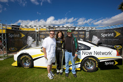 The charming Miss Sprint Cup Monica with fans