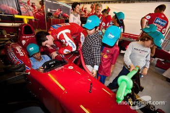 Alexander Rossi meets local children visiting the GP2 paddock