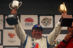 Podium: Garry Holt holds the trophies aloft