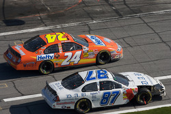 Eric McClure and Joe Nemechek battle on pit road